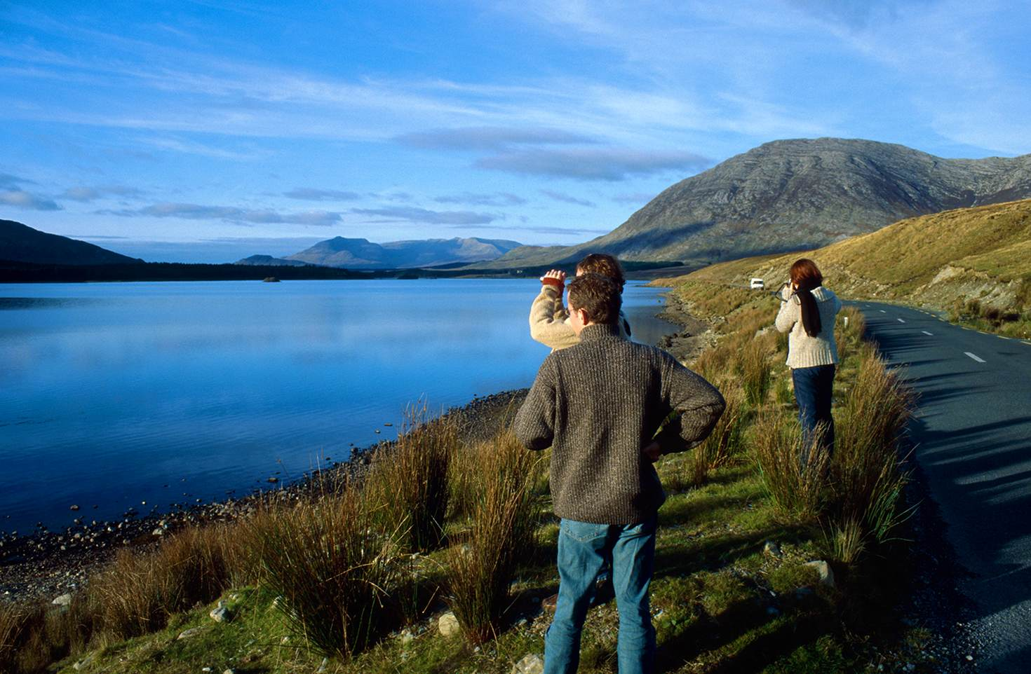 Travellers gaze at the astonishing scenery of Connemara