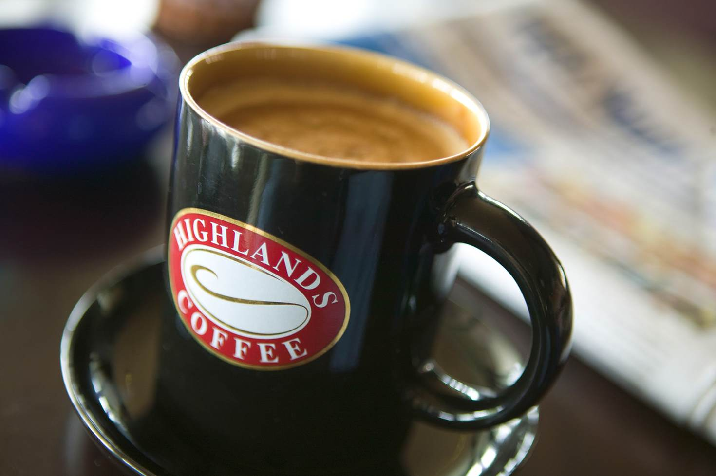 A mug of Highlands Coffee in Hanoi, where the coffee scene is developing fast © Brent Winebrenner / Getty Images