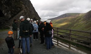 Tour group with guide at the Entrance to Honister Slate Mine, Cumbria August PM. Image shot 08/2008. Exact date unknown.BBKTAJ Tour group with guide at the Entrance to Honister Slate Mine, Cumbria August PM. Image shot 08/2008. Exact date unknown.