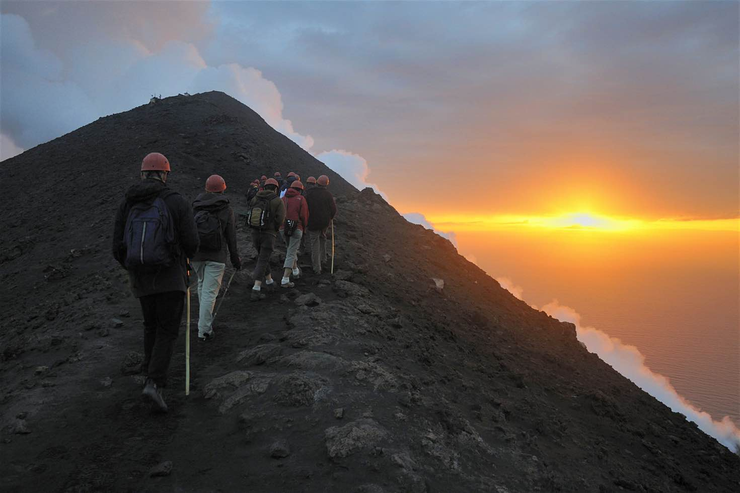 Hiking up Stromboli's black volcanic cone at sunset