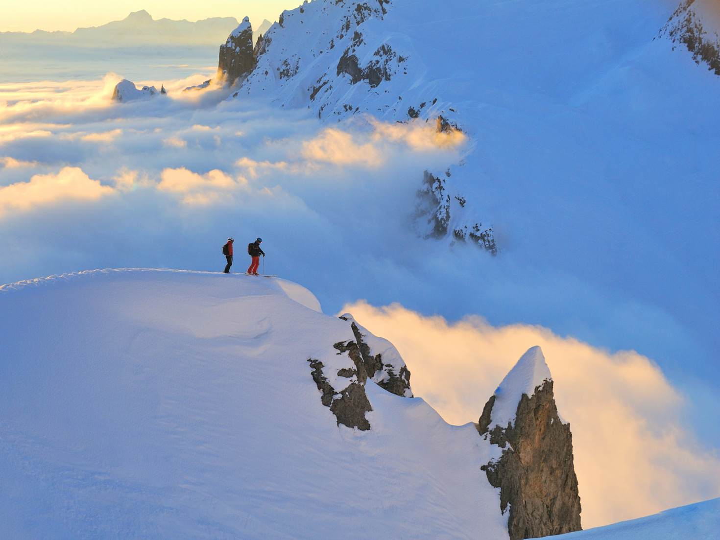 Two skiers look over Austria's biggest ski area © Lech Zürs Tourismus