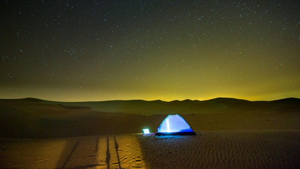 A tent sits in the sand of the Al Ain southern desert overnight, just outside of Abu Dhabi.